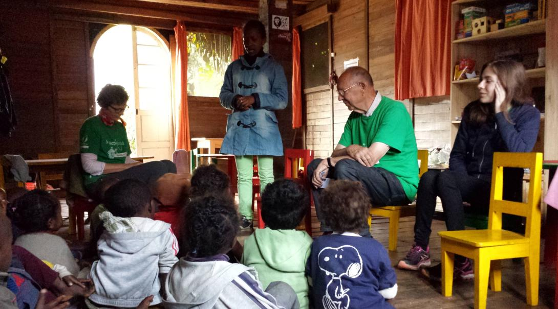 A group of Projects Abroad Public Health volunteers have a conversation with kids in a school in Madagascar during their internship with Projects Abroad to promote hygiene practices.